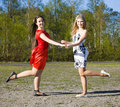 Two girls dancing in the park Royalty Free Stock Photo