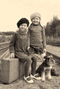Two girls and a dog go by rail little traveling with miniature schnauzer Stock Photos
