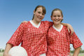Two girls dressed to play football portrait of happy young against clear sky Stock Images