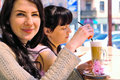Two girls drinking cappuccino Stock Photo