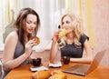 Two girls drinking tea Stock Photos