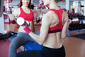 Two girls with dumbbell in fitness club Royalty Free Stock Photo