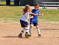 Two Girls Fighting for the Ball/Soccer Royalty Free Stock Photo