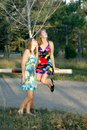 Two girls in a forest green Royalty Free Stock Photos