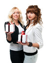 Two girls give gifts in suits wrapped Stock Photo