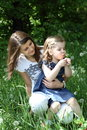 Two girls on the glade with dandelions Royalty Free Stock Photography