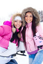 Two girls go ice skating Royalty Free Stock Photo