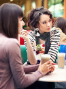 Two girls gossip Stock Photos