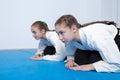Two girls in hakama bow on aikido training black Stock Photo