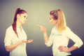 Two girls having argument, interpersonal conflict Royalty Free Stock Photo