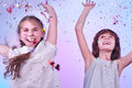Two girls having fun and dancing studio portrait of joyful Stock Photos