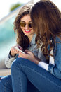 Two girls having fun with smartphones pretty Royalty Free Stock Photography