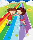 Two girls holding their hands at the colorful road illustration of Royalty Free Stock Photo