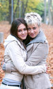 Two girls hugging in nature Royalty Free Stock Photo