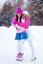 Two girls ice skating Stock Image