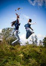Two girls jumping high excited Royalty Free Stock Photo