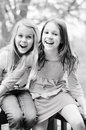 Two girls laughing young pre teen together Stock Photography