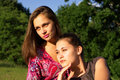 Two girls leaning in sunset light Royalty Free Stock Image