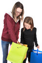 Two girls looking in bags Stock Image