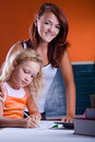 Two girls making homework Royalty Free Stock Photography