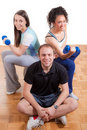 Two girls and man exercising with weights Royalty Free Stock Photo