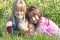 Two girls in meadow Stock Photo