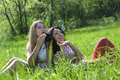 Two girls on the meadow Stock Images