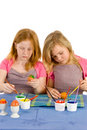 Two girls painting easter eggs Stock Image