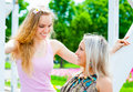 Two girls in the park young women having fun outdoors Royalty Free Stock Photo