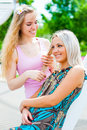Two girls in the park young women having fun outdoors Stock Image