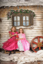 Two girls in pink for Christmas Royalty Free Stock Photo