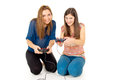 Two girls play video games on the joysticks Stock Photo