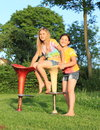 Two girls playing on bar chairs Royalty Free Stock Photo