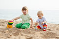 Two girls playing on the beach beautiful play Royalty Free Stock Image