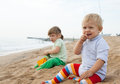 Two girls playing on the beach beautiful play Stock Photography