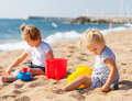 Two girls playing on beach cute the Stock Photos