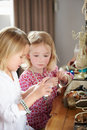 Two girls playing with jewelry and make up young Stock Image