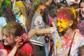Two girls playing with paint the festival of colors holi in cheboksary chuvash republic russia holiday joy Royalty Free Stock Images