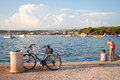 Two girls playing on a sea shore near a bicycle Royalty Free Stock Photo
