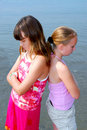 Two girls pouting Stock Images