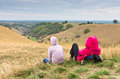 Two girls resting at the begining of a valley between small hills north serbia Royalty Free Stock Image