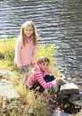 Two girls by the river Royalty Free Stock Photo