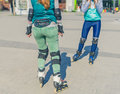 Two girls rollers meet each other in the park Royalty Free Stock Photo
