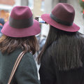 Two girls in the same burgundy hats make selfie