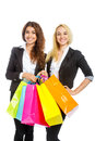Two girls with shopping bags isolated on white Royalty Free Stock Images