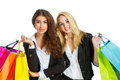 Two girls with shopping bags isolated on white Stock Photos