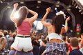Two girls on shoulders in the crowd at a music festival Royalty Free Stock Photo