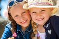 Two girls smiling together close up face shot of young girlfriends with heads outdoors Royalty Free Stock Photo