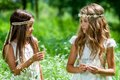 Two girls standing in flower field. Royalty Free Stock Photo