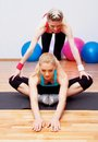 Two girls stretching in club Royalty Free Stock Photo